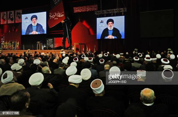 Lebanese Hezbollah Leader Hassan Nasrallah delivers a televised speech during a ceremony held by the Shiite party in the capital Beirut commemorating...