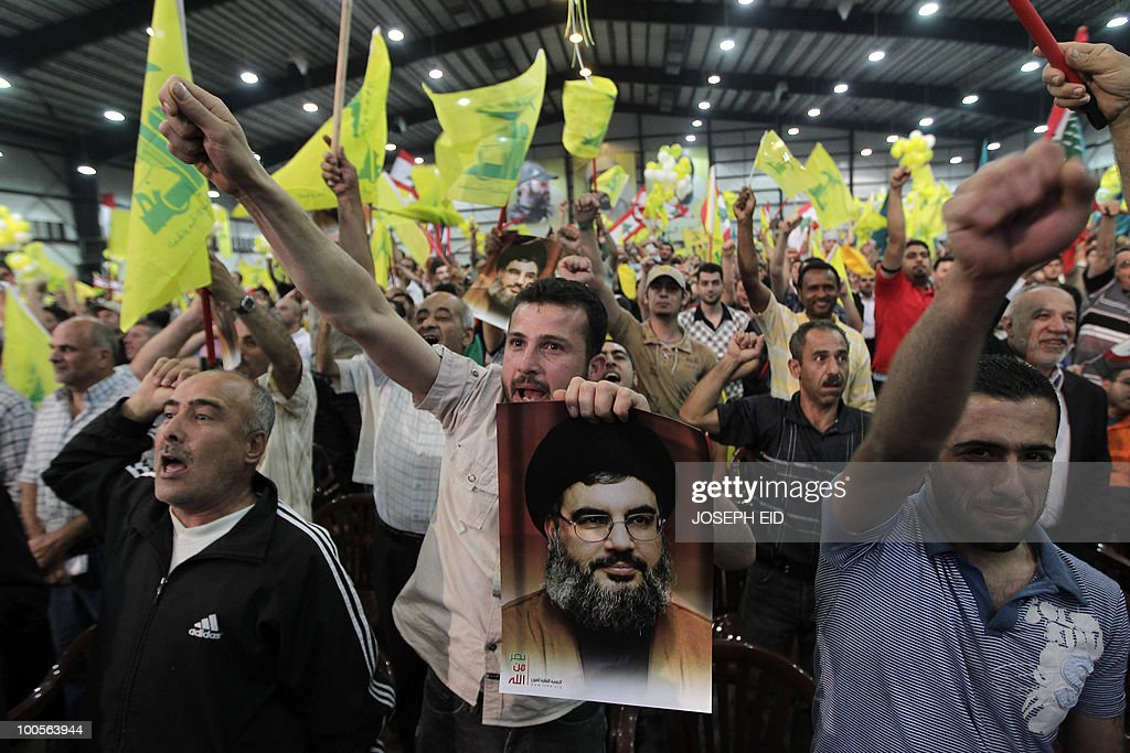 Lebanese Hezbollah supporters shout slogans as party leader Hassan Nasrallah (picture) delivers a televised speech during a ceremony marking the 10th anniversary of Israel's withdrawal from southern Lebanon in southern Beirut on May 25, 2010. Nasrallah said that his militants are capable of wiping out Israel's navy and any other ships heading to Israel in the event of a new war with the Jewish state.
