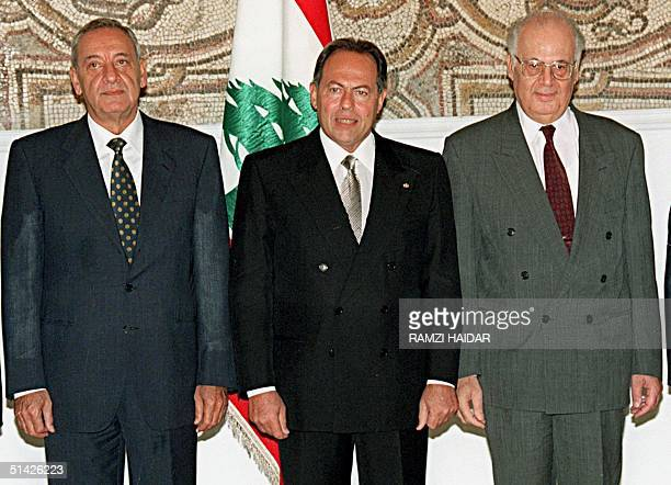 Lebanese house speaker Nabih Berry , President Emile Lahoud and Prime Minister Salim Hoss pose after the first meeting of the newly-appointed cabinet...