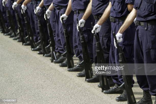 Lebanese Internal Security Forces stand at attention before the start of military maneuvers at an ISF base in the town of Dbayeh north of Beirut on...