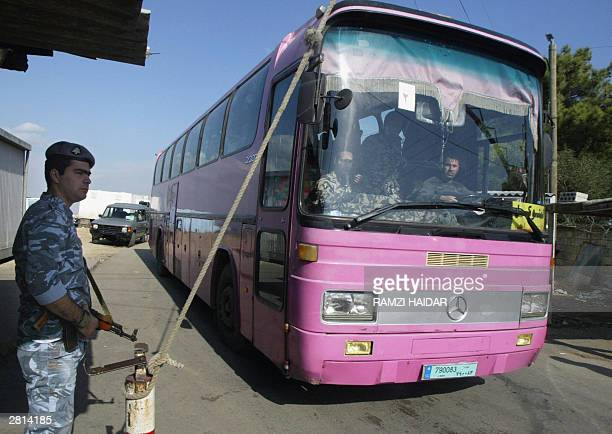 Lebanese internal security guard stands 16 December 2003 at the gate of Roumieh prison northeast of Beirut as buses repatriate by land Iraqis who had...
