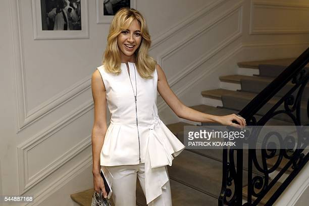 Lebanese jewelry designer Sabine Getty poses before Christian Dior 20162017 fall/winter Haute Couture collection fashion show on July 4 2016 in Paris...