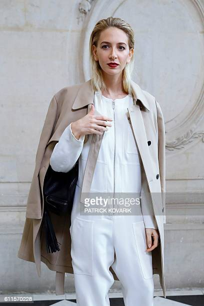 Lebanese jewelry designer Sabine Getty poses before the Christian Dior 2017 Spring/Summer readytowear collection fashion show on September 30 2016 in...