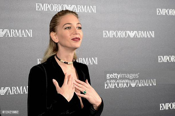 Lebanese jewelry designer Sabine Getty poses before the Emporio Armani 2017 Spring/Summer readytowear collection fashion show on October 3 2016 in...