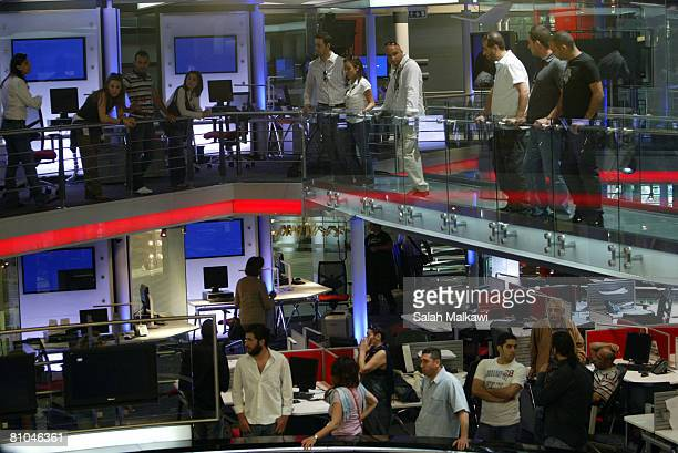 Lebanese journalists and employees gather in the studios of the Future TV News channel following a protest for the reopening of the television...
