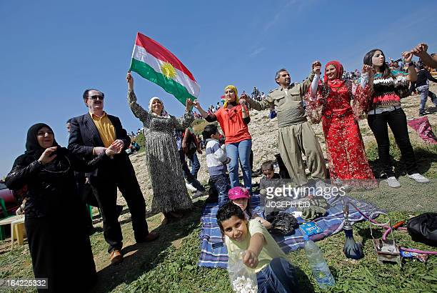 Lebanese Kurds waving the Kurdish flag celebrate Noruz in the capital Beirut on March 21 2013 The Persian New Year is an ancient Zoroastrian...