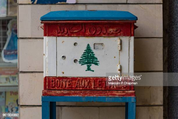 lebanese mailbox with national flag, byblos, lebanon - libanon stock-fotos und bilder