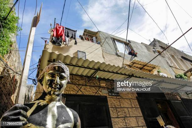 A Lebanese man dressedup in a carnival costume takes part in the Zambo carnival held in the northern Lebanese port city of Tripoli on March 10...