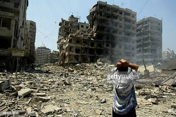 A Lebanese man reacts as he looks at destruction caused by Israeli air strikes in the southern suburbs of Beirut a strong hold of Hezbollah 25 July...