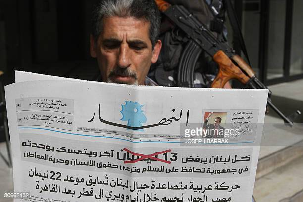 A Lebanese man reads a copy of AnNahar newspaper in Beirut on April 14 2008 All Lebanese newspapers published the same headline on its frontpages...