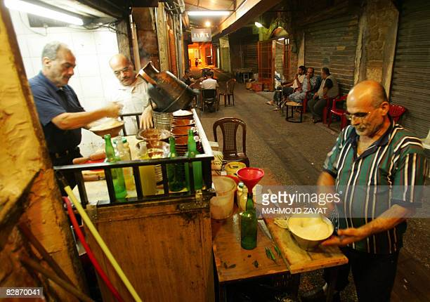 Lebanese man sells traditional Arabic 'Hummos' and 'Foul' dips from his street restaurant in the southern city of Tyre early September 18 2008 During...