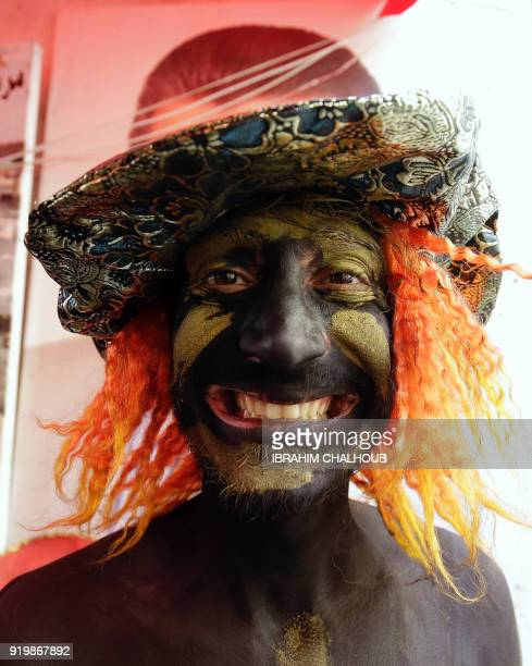 A Lebanese man takes part in the Zambo carnival held in the northern Lebanese city of Tripoli on February 18 to mark the last period of excess on the...