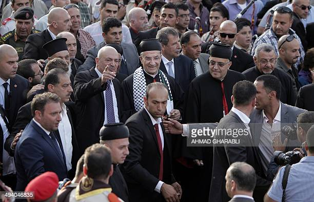 Lebanese Maronite patriarch Beshara Rai greets the crowd upon his arrival to attend a Mass in the West Bank town of Beit Sahur near Bethlehem on May...
