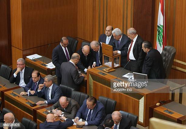 Lebanese members of parliament count the votes after casting their ballots to elect the new Lebanese president in the parliament building in downtown...