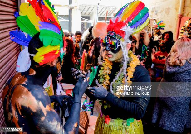 Lebanese men and women dress up in carnival costumes as they take part in the Zambo carnival held in the northern Lebanese port city of Tripoli on...