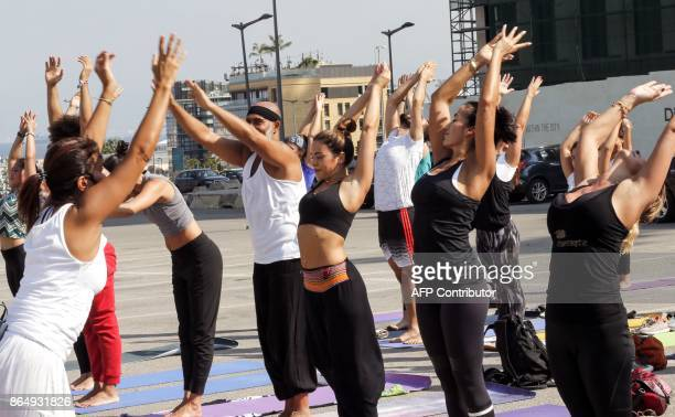 Lebanese men and women practice yoga during the special 108 Sun Salutations event in the capital Beirut's Martyrs Square on October 22 2017 / AFP...