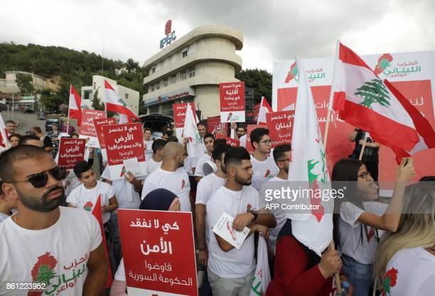 Lebanese men and women take part in a protest on October 14 2017 in the northern town of Zouk Mosbeh calling for the departure of Syrian refugees who...