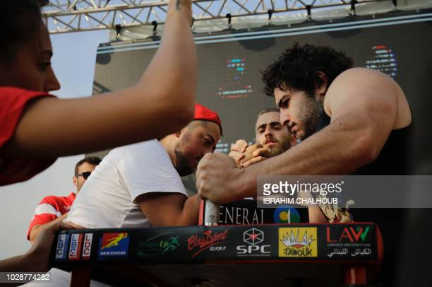 Lebanese men compete in an armwrestling championship in the coastal city of Jounieh on July 13 2018 As far back as the 19th century men in villages...