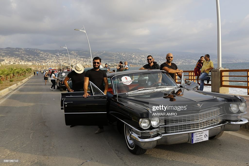 Lebanese Men Pose Next To A Vintage Car During The Classic Cars Show - Next car show near me