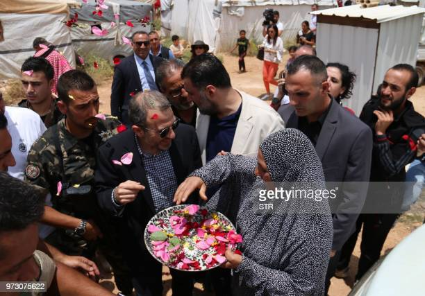 Lebanese Minister of Foreign Affairs and Expatriation Gebran Bassil is greeted with flower petals at a Syrian refugee camp in the town of Arsal on...