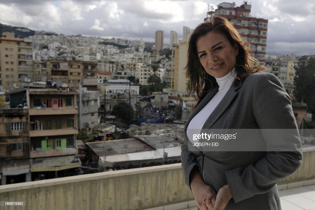 Lebanese model and modeling agency owner Nathaly Fadlallah poses on the balcony of her office in Beirut on January 29, 2013. Fadlallah is one of two fashion models who have have stirred controversy and set a precedent by announcing that they will run in the upcoming parliamentary elections in spring.