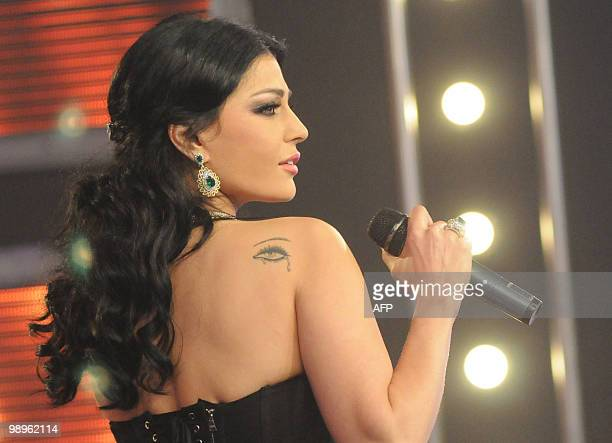 Lebanese model and pop star Haifa Wehbe performs at the ART music film and TV awards event in Cairo late on May 10 2010 Wehbe won the best...