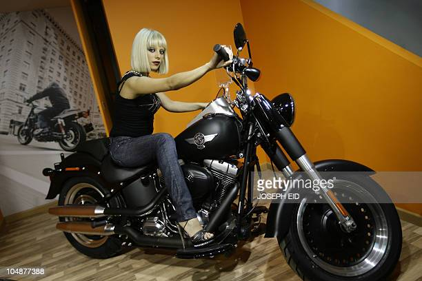 A Lebanese model poses on a HarleyDavidson motorcycle during the opening of the iconic US motorcycle maker's first showroom in Beirut on September 23...