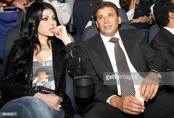 Lebanese model singer and actress Haifa Wehbe attends Egyptian film director Khaled Yussef the screening of their new film 'Dokan Shehata' in Dubai...