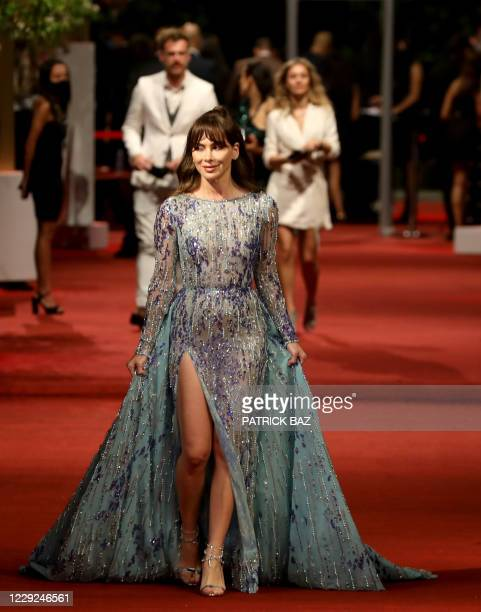 Lebanese model Stephanie Saliba walks the red carpet at the opening ceremony of the 4th edition of El Gouna Film Festival, in the Egyptian Red Sea...