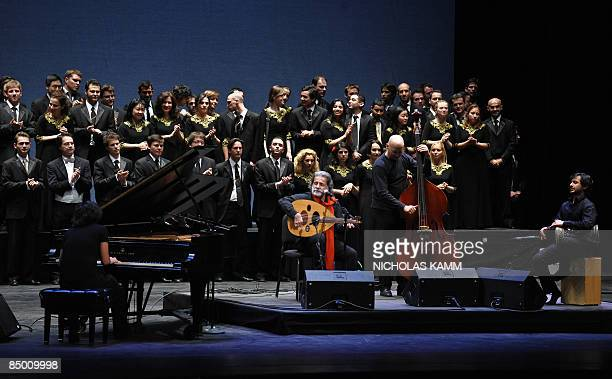 Lebanese musician Marcel Khalifa performs with his alMayadin Quartet and members of the Qatar Philharmonic Orchestra at the opening of the Kennedy...