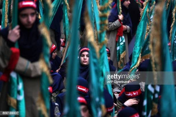 Lebanese Muslim Shiite girl scouts affiliated to Hezbollah march as they mark Ashura in a southern suburb of Beirut on October 1 2017 The religious...