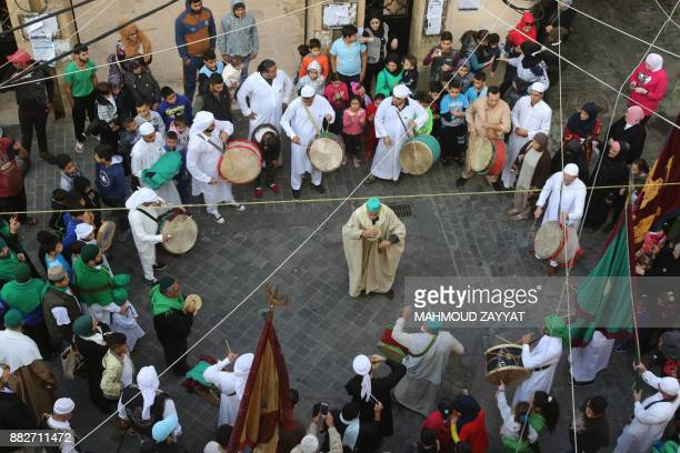 Lebanese Muslim Sufi men attend a ritual ceremony to mark the birth of Prophet Mohammed on November 30 2017 in the southern city of Sidon Muslims...