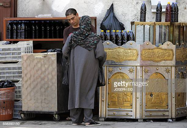 A Lebanese Muslim woman shops prior to Iftar or breaking of the daylong fast in the old market in the ancient coastal city of Tripoli north of Beirut...