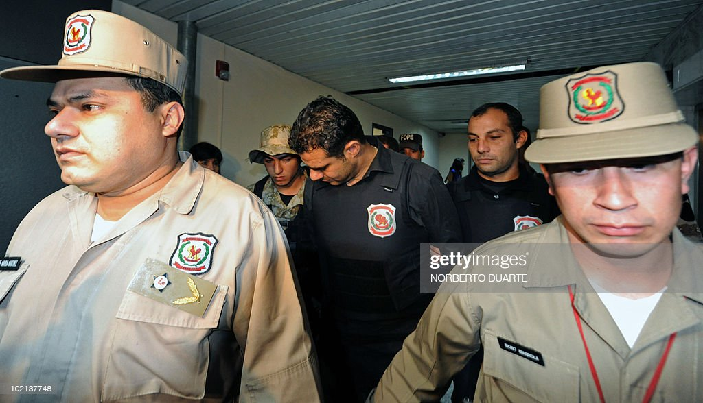 Lebanese national Moussa Hamdan (C) is escorted upon arrival to the palace of Justice in Asuncion, to give evidence on the trail at which he faces charges for allegedly financing Shiite militant group Hezbollah, on June 16, 2010. Hamdan, 38, was arrested, following an Interpol arrest warrant, in Ciudad del Este, part of the Triple Frontier, a region the United States has repeatedly cited as being exploited by militant groups that 'finance terrorist activities.' AFP PHOTO/Norberto Duarte