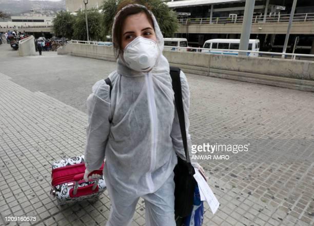 Lebanese national, residing in Saudi Arabia, arrives at the Beirut international airport on April 5, 2020. - Lebanon started repatriating nationals...