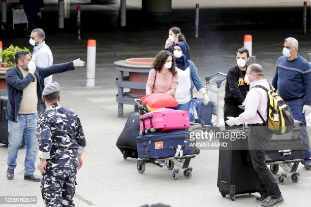 Lebanese nationals, residing in Saudi Arabia, arrive at the Beirut international airport on April 5, 2020. - Lebanon started repatriating nationals...