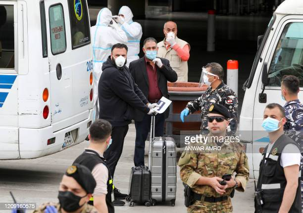 Lebanese nationals, residing in Saudi Arabia, arrive at the Beirut international airport on April 5, 2020. - Lebanon started repatriating nationals...