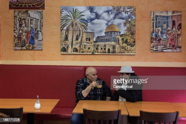Lebanese native bar owner Jakoubs Schoubi drinks tea with the actor Ahmed Kraemer at Sonnenallee in Neukoelln district on October 29 2013 in Berlin...