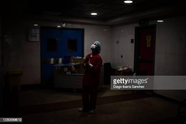 Lebanese nurse prays inside the corridors of the Intensive Care Unit of Rafik Hariri University Hospital on January 15 in southern Beirut, Lebanon....