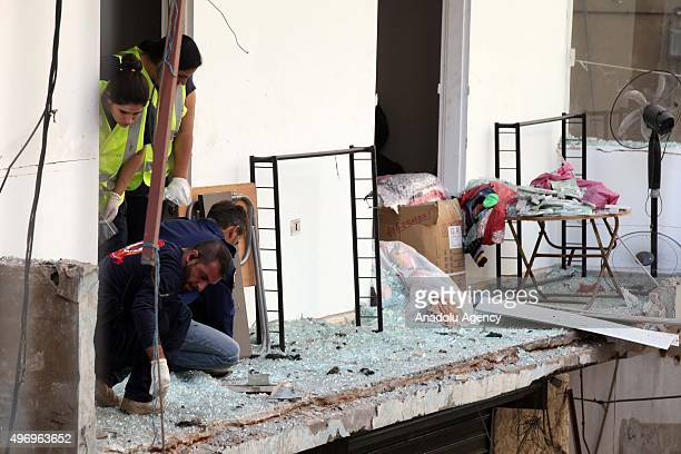 Lebanese officials inspect an area where two explosions took place at Dahieh, know as Hezbollah stronghold, South Beirut, Lebanon on November 13,...