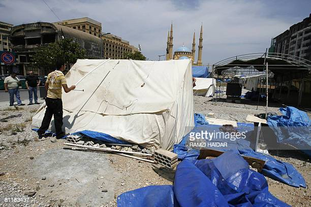 Lebanese opposition supporter starts to remove his tent from downtown Beirut on May 21, 2008. Members of Lebanon's Hezbollah-led opposition today...