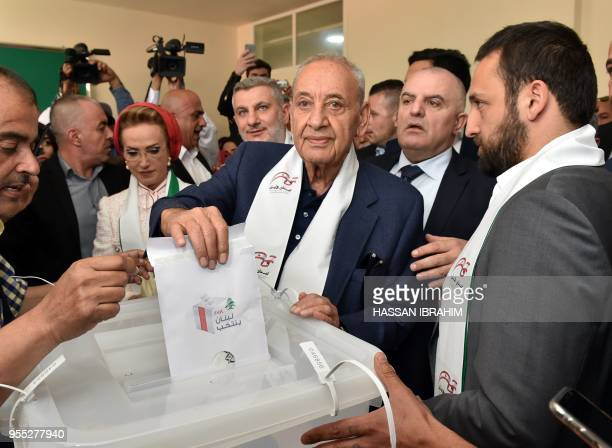 Lebanese Parliament Speaker Nabih Berri casts his vote in the country's first legislative election in nine years at a polling station in the southern...