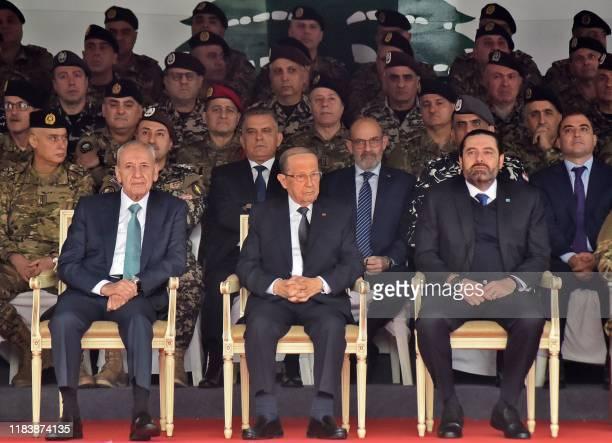 Lebanese Parliament speaker Nabih Berri, President Michel Aoun, and Prime Minister Saad Hariri attend a military parade commemorating the 76th...
