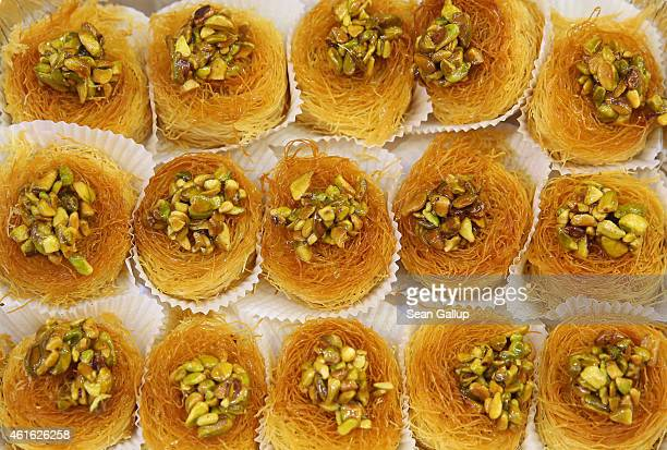 Lebanese pastries with pistachios lie on display at a stand at the International Green Week agricultural trade fair on January 16 2015 in Berlin...