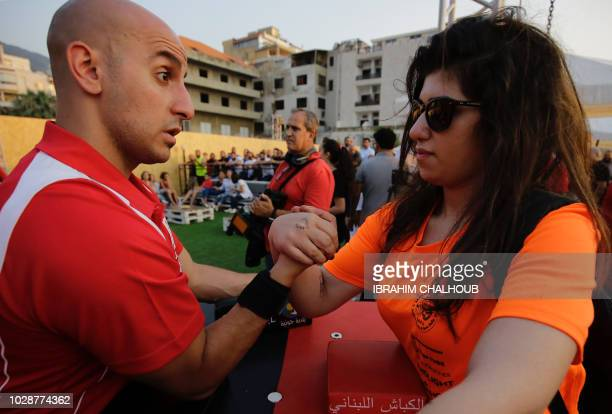 Lebanese people compete in an armwrestling championship in the coastal city of Jounieh on July 13 2018 As far back as the 19th century men in...