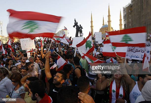 Lebanese people gather at the Martyrs' Square during a rally to protest the ongoing garbage crisis and alleged government corruption on August 29...