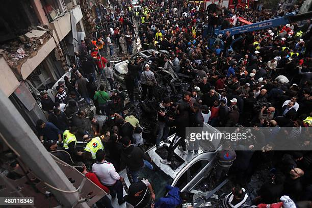 Lebanese people gather at the site of a car bomb that targeted Beirut's southern suburb of Haret Hreik on January 2 2014 A large car bomb killed five...