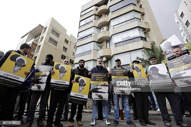 Lebanese people hold banners during the protest after Sheikh Ibrahim ElZakzakywho was arrested on sunday in Nigeria in Beirut Lebanon on December 19...