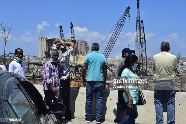 Lebanese people inspect the site after the deadly explosion at the Port of Beirut led to massive blasts on 4th August in Beirut, Lebanon on August...