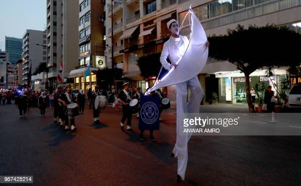 Lebanese people march in the capital Beirut on May 11 ahead of the start of the Muslim holy fasting month of Ramadan